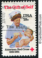 nurse with a child - UNITED STATES - CIRCA 1981: stamp...