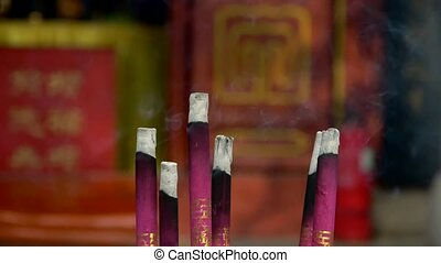 Smoke-filled burning incense,In temple.