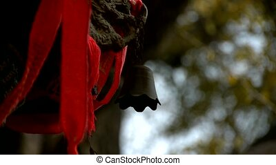 Dragon and metal bell on censer,Red ribbon blowing in...