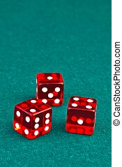 three reds dice on green - detail of three reds dice on...