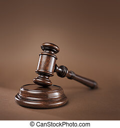 The Law - High quality wooden gavel and block on brown...