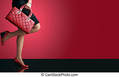 fashion - Woman sexy legs with handbag. Shopping and...