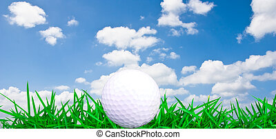 Golf ball on grass over blue sky background