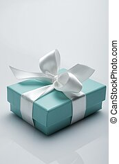 luxury gift - small turquoise box tied with a white ribbon