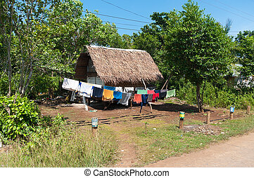 laundry drying - laundry hanging on a line next to a small...