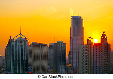 Shanghai sunset with skyscrapers background