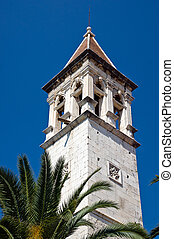 Old church belltower in ancient part of Trogir. Croatia.
