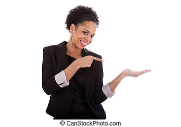 Young african american woman presenting something on empty palm