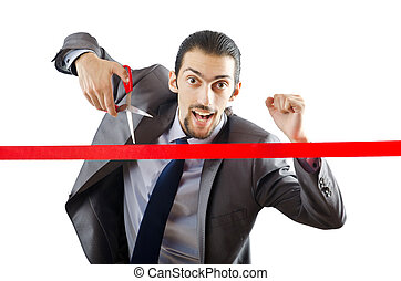 Businessman crossing finish line