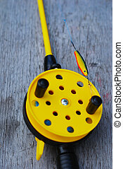 fishing rod with yellow reel