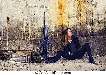 mercenary girl with machine gun and ammo