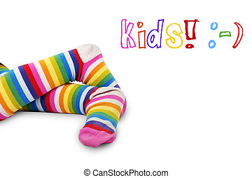 Colorful kids feet - Funny shot of a little girls crossed...