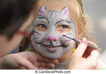 Face painting - Little girl with painting face as a cat