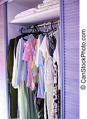 Clothes in closet - Clothes with hangers in closet vertical...