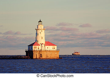 Chicago Light House with boat in Lake Michigan with cloud...