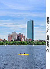 Boston Charles River with urban city skyline Hancock...