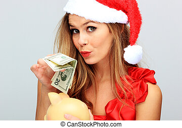 Beautiful Young Happy Christmas Woman holding a pig money...
