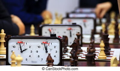 Close-up of chess game tournament with clock Time lapse
