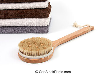 Scrubber with towels - Various towels and a scrubber with a...