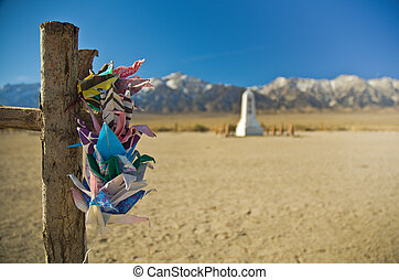 Paper Cranes at Manzanar - Colorful paper cranes hanging on...
