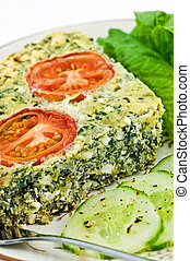 Spinach and feta cheese quiche with lettuce and cucumber in...