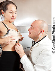 doctor examining the patient
