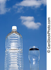 Bottle in the blue sky - Clear plastic bottle and water in...