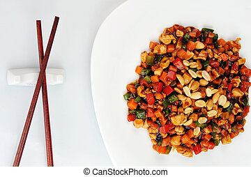 steamed vegetables and meat with peanut on plate. Chinese...