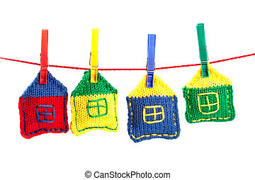 four knitted colorful houses on a red string isolated on...