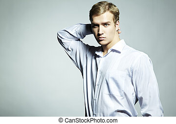 Fashion portrait of young beautiful man on a white...