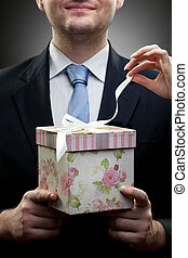 closeup portrait of businessman holding gift with womans...