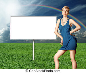 billboard and sexy blonde on green grass and blue cloudly...