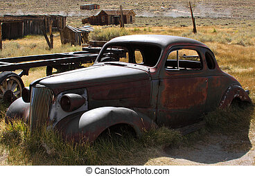 Vintage Car - 1937 Chevy without wheels abandoned in the...
