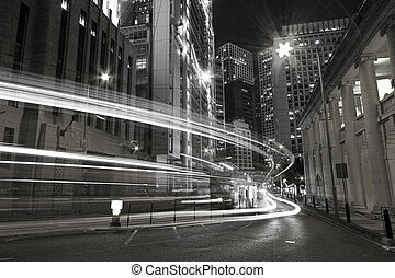 Traffic in city at night in black and white toned