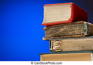 A pile of books on a blue background