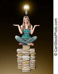 woman in lotus pose balancing on pile of books and bulb