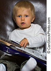 Boy with Electric Guitar - Young boy holding an electric...