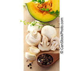Mushrooms and kabocha pumpkin with spices and herbs on...