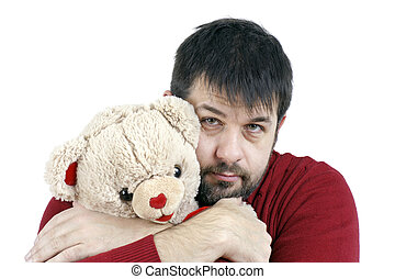 Guy hugging teddy bear - Contradiction: big tough middle age...