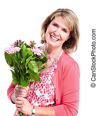 Happy senior woman with flowers. - Happy senior woman with...