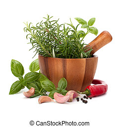 fresh flavoring herbs and spices in wooden mortar isolated...