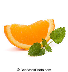 Orange fruit segment and citron mint leaf isolated on white...