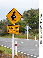 Sign caution pinguins near Punakaiki, Region West Coast,...