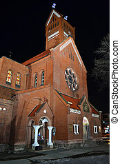 Red Catholic church in the center of Minsk at night