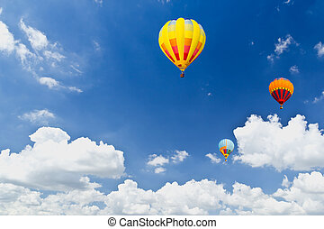 colorful hot air balloons in blue sky