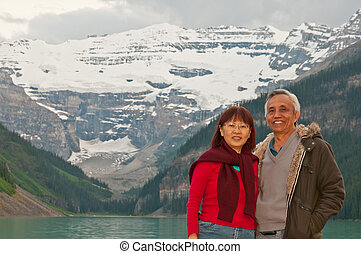 Happy seniors smiling during vacation to Lake Louise