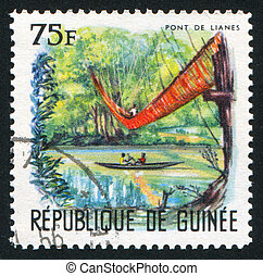 Liana bridge - GUINEA CIRCA 1966: stamp printed by Guinea,...