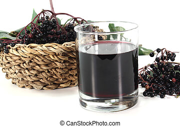 Elderberry juice with elderflower berries and leaves on a...