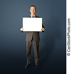 happy businessman holding blank white card in his hands