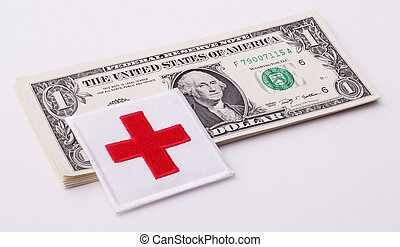 Red Cross on a wad of one-dollar bills